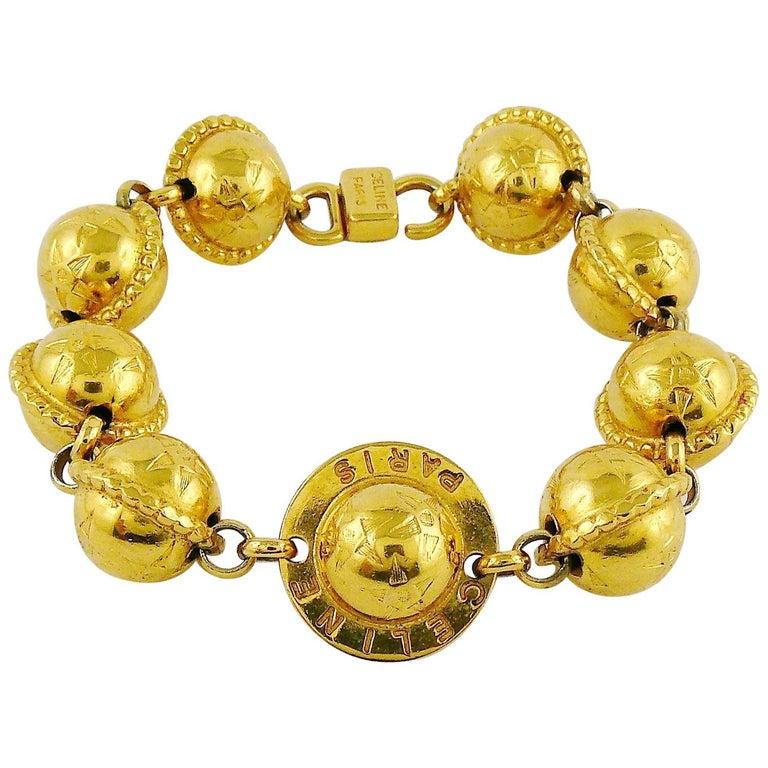 Celine Vintage 1991 Iconic Gold Toned Planispheres Bracelet For Sale