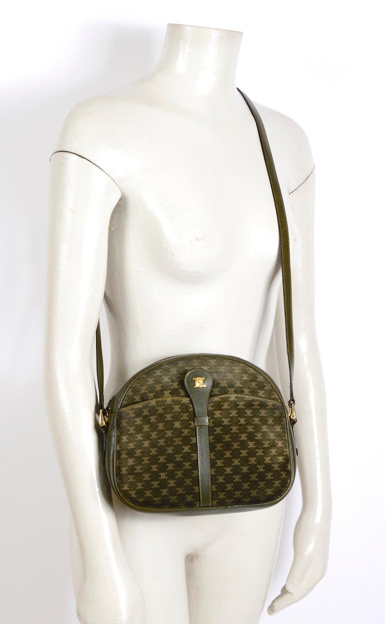 Vintage Celine hunter green trimmed with leather, suede crossbody bag. This pre-owned bag has been well taken care of and aged beautifully, a few scratches here and there but no damage as you will find the corners in perfect condition. One