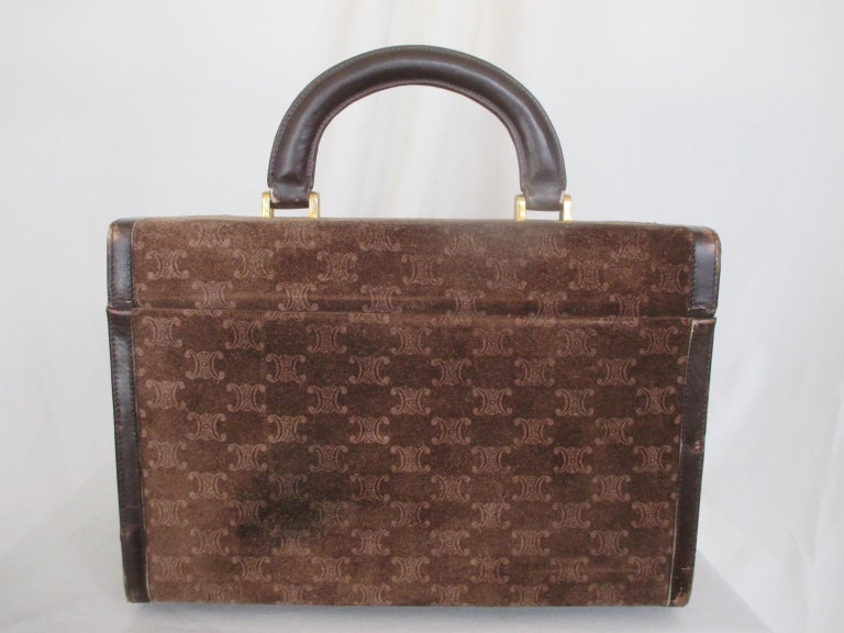 Celine authentic vintage cosmetic traveling case  View our frontstore for more exclusive items  Details: Rare Celine vanity case from circa 70s. In leather and dark brown suede with embossed macadam monogram logo. With lock (no key) at the front and