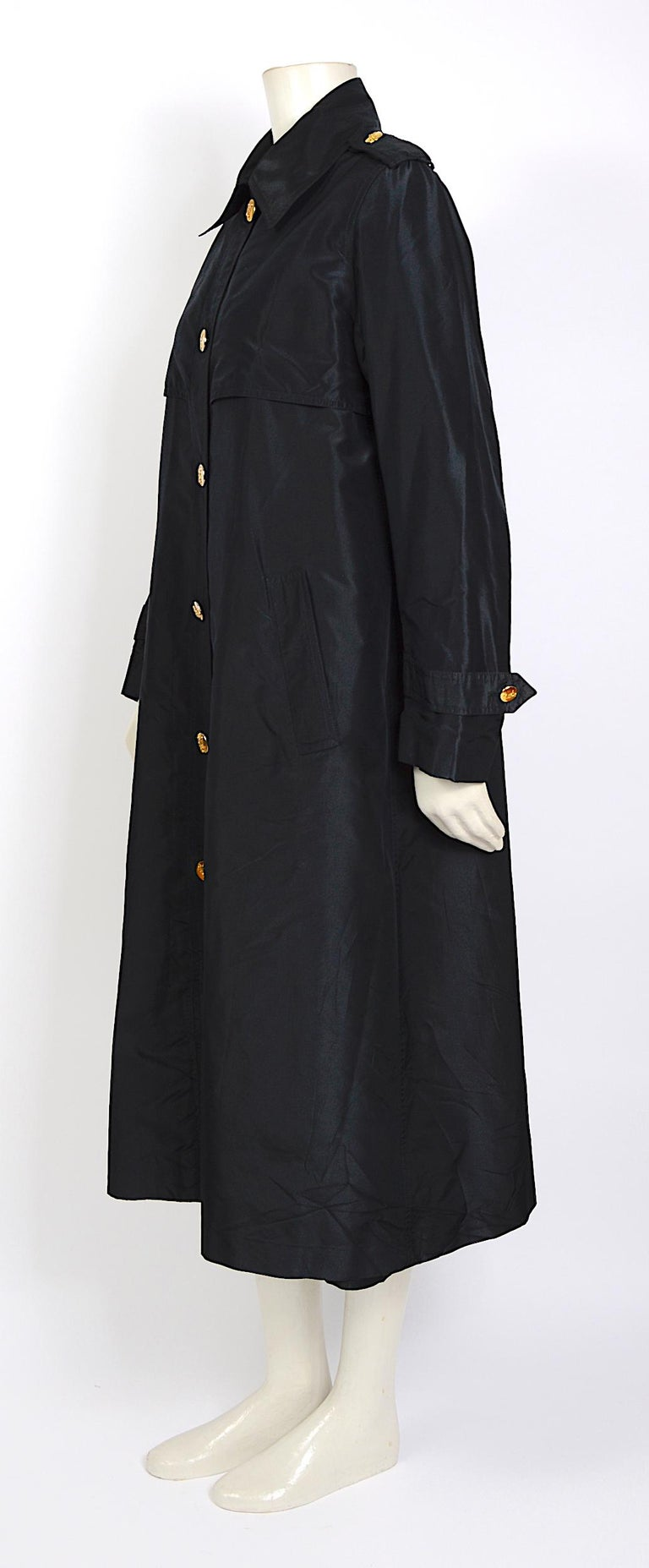 Celine vintage elegant cool A-Line style black crispy taffeta silk coat with gold signature buttons.  The coat is in fabulous condition but you will notice some light fading on the gold buttons - French size 38. Please use the given measurements for