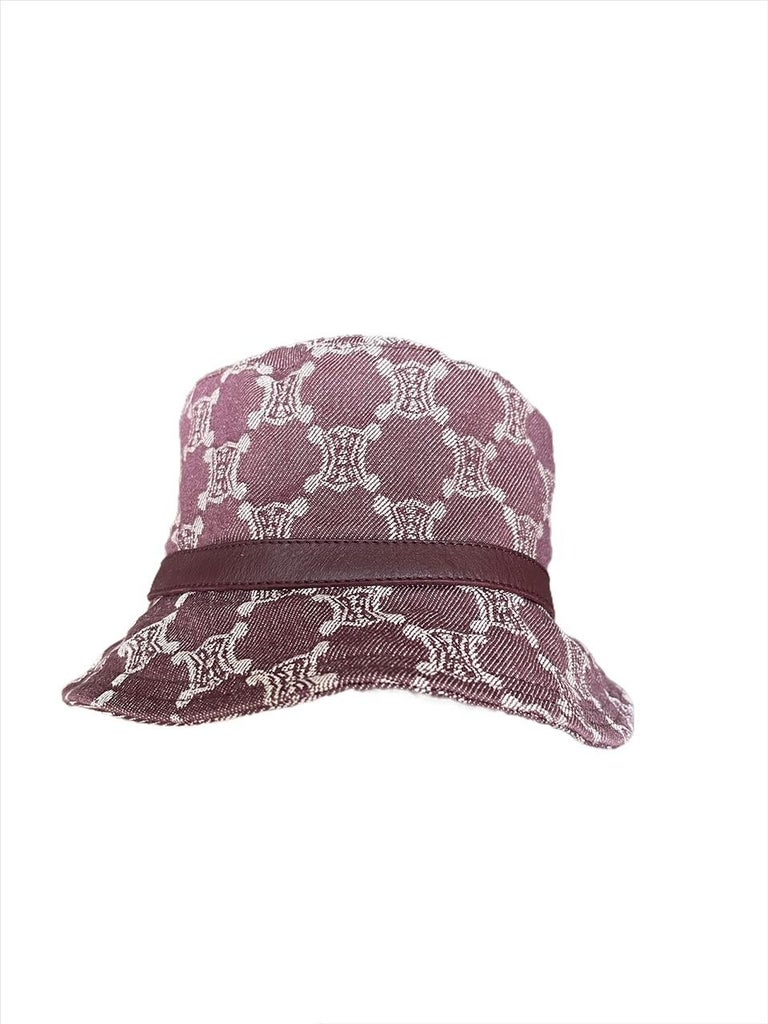 CELINE, Made in Italy. Eggplant color denim bucket hat with Triomphe logo all-over with leather trimming.  Size S.