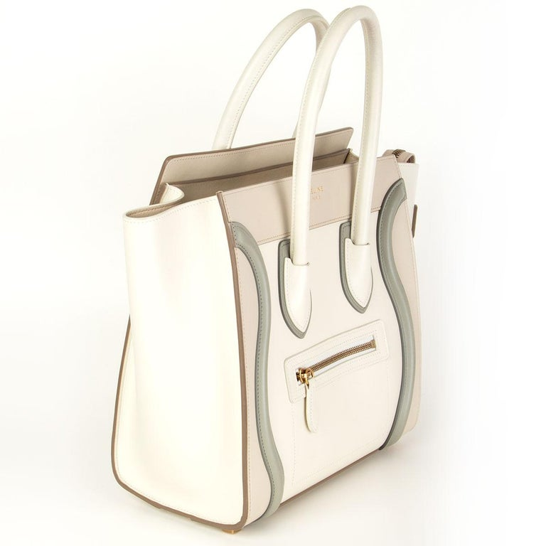 Céline 'Micro Luggage' in off-white, begie and sage grey calfskin. Opens with a zipper on top and is lined in beige calfskin with one zippe pocket against the back and two open pockets against the front. Has been carried with some pen marks on the
