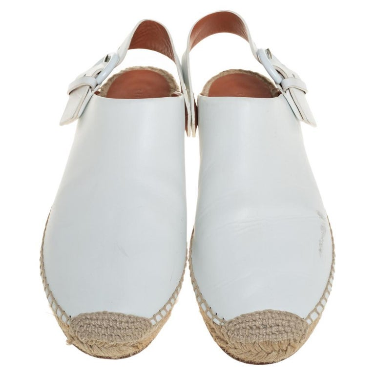 Flaunt style at its best with these beautiful leather flats. This white pair from Celine is a fine example of exquisite design. The mules feature covered toes and back strap closure with buckle fastening. They are sure to assist you with ease.