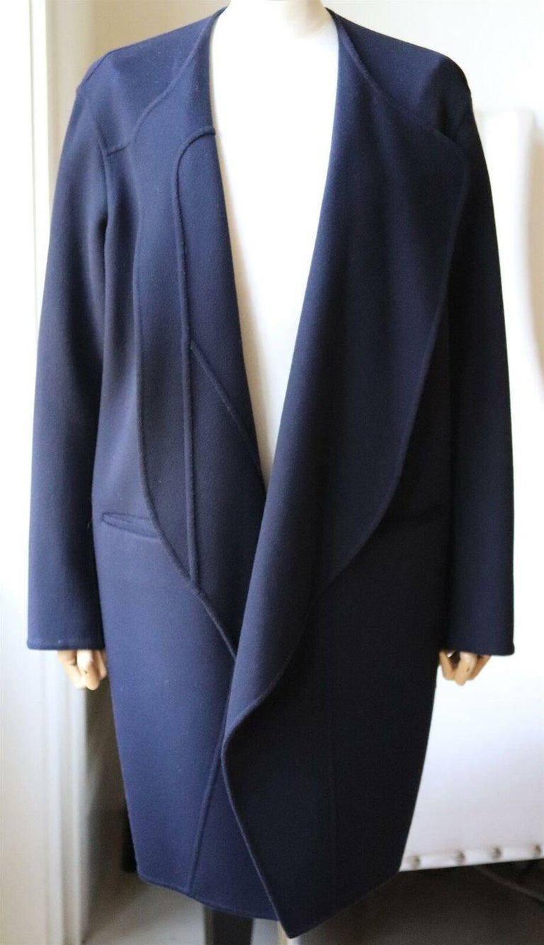 This Céline by Phoebe Philo coat has been made from wool with hints of soft cashmere, the oversized silhouette has large lapels and pockets. Navy wool and cashmere-blend.  Slips on. 90% Wool, 10% cashmere; lining: 100% cupro. Size: FR 40 (UK 12, US