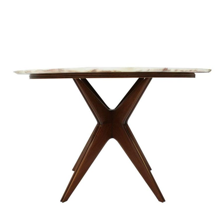 Celler table composed of a four-legged central foot made of rosewood with brass details and green onyx top, Italy, 1950.