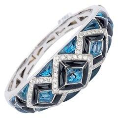 Cellini 18 Karat Gold Bangle Bracelet with Diamonds, Blue Topaz and Black Onyx