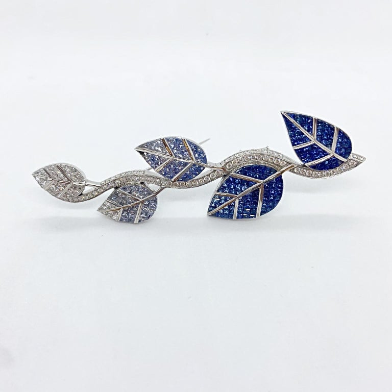 Modern Cellini 18 Karat Gold Diamonds and Invisibly Set Ombre Blue Sapphire Leaf Brooch For Sale