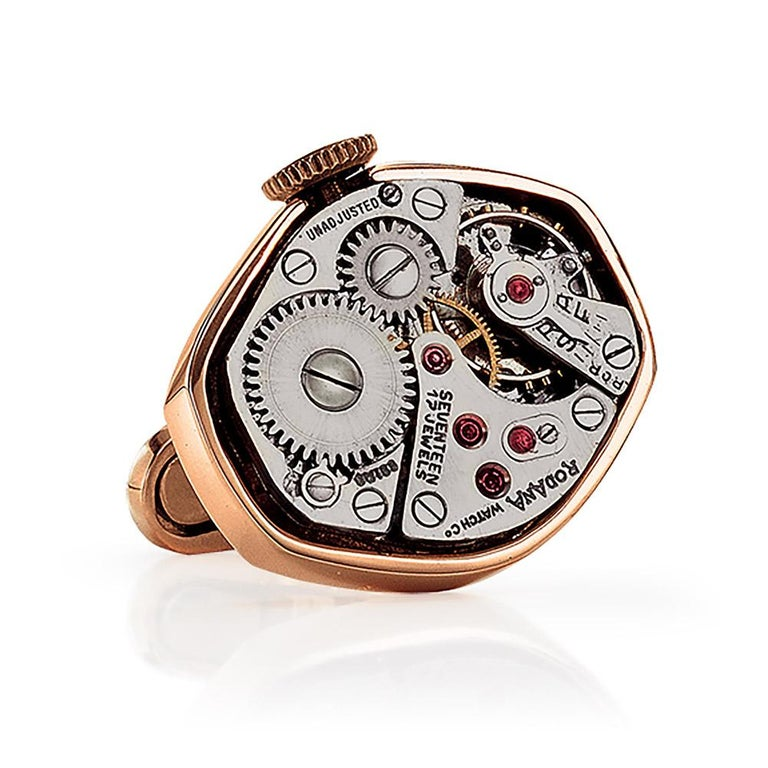 Made exclusively for Cellini Jewelers NYC, these 18 karat rose gold hexagonal shaped cuff links have been set with stainless steel vintage watch movements. The perfect gift for any watch enthusiast. The cuff links measure 3/4