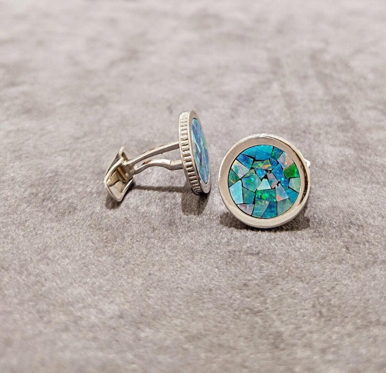 These magnificent 18 kt white gold round cuff links are inlaid with a beautiful opal mosaic pattern. The detailed coin edge further elevates the design. Stamped with the CELLINI logo, these stunning and unique cufflinks are sure to make a