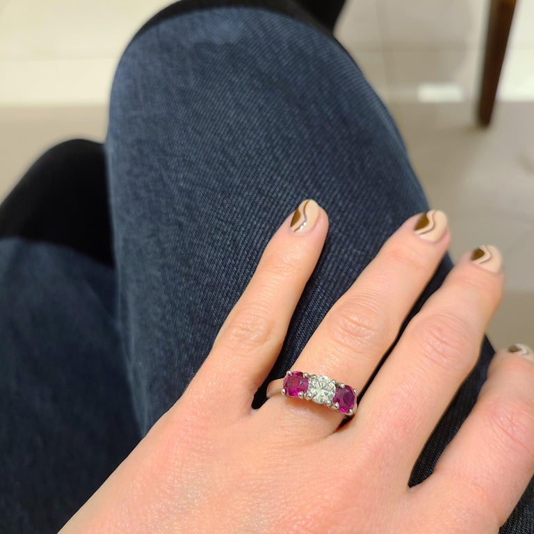 Contemporary Platinum 3 Stone, 1.63 Carat Ruby and .61 Carat Diamond Ring For Sale