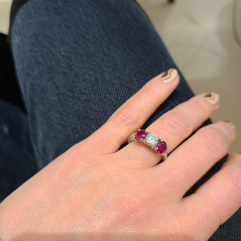 Round Cut Platinum 3 Stone, 1.63 Carat Ruby and .61 Carat Diamond Ring For Sale