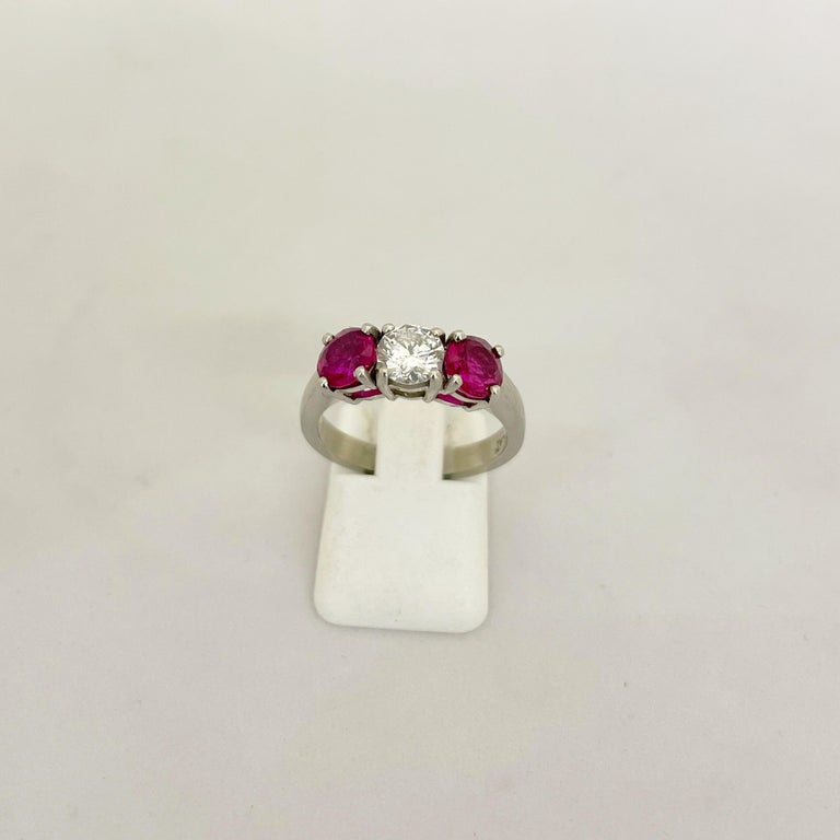 Platinum 3 Stone, 1.63 Carat Ruby and .61 Carat Diamond Ring For Sale 1