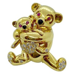 Cellini NYC 18 Karat Gold Mama and Baby Teddy Bear Brooch with Diamonds and Ruby