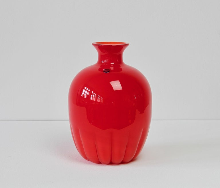 Colorful (colorful) vintage midcentury bright red vase by Cenedese Vetri of Murano, Italy, circa 1970s-1990s. Particularly striking is the narrow necked round form with rippled base, very similar to Napoleon Martinuzzi bowls for Venini in the