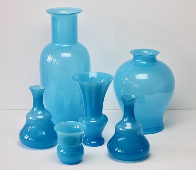 Cenedese set, group, ensemble or collection of vintage midcentury Murano glass vases or vessels, made in Italy, circa 1970-1990. Particularly striking is the light opaline blue colour / color as well as the forms and large sizes, they have all the