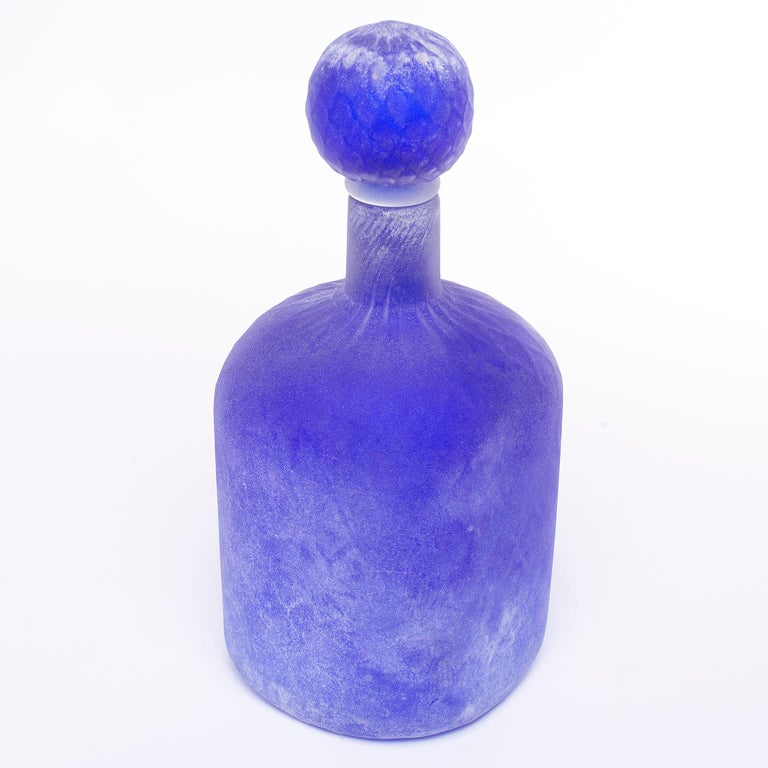 Blue Scavo style Murano glass bottle and stopper by Cenedese, circa 1970s. Original label still affixed. Excellent vintage condition with no flaws found.