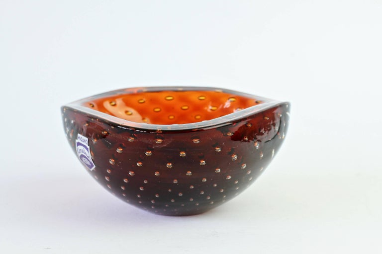 Small petite little Italian bowl or ashtray in the style of Venini by Cenedese. Made from amber colored / coloured Murano glass bullicante or