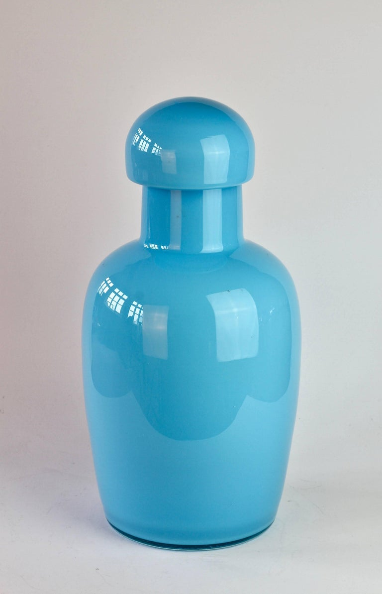 Wonderful tall light blue urn by Cenedese Vetri of Murano, Italy. A fun, funky and bright way to add a touch of bold colour / color to your interior - imagine glass like this on open, white shelving in a kitchen, bathroom or in a display