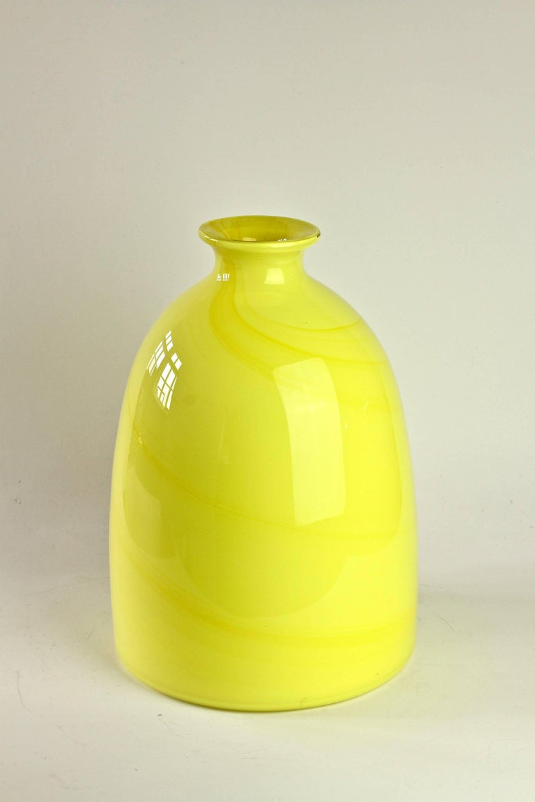 Wonderfully colourful / colorful tall bright yellow vase by Cenedese Vetri of Murano, Italy. Particularly striking is the form - with it's flat base and narrow neck - it has all the characteristics of a piece of hand thrown pottery with the