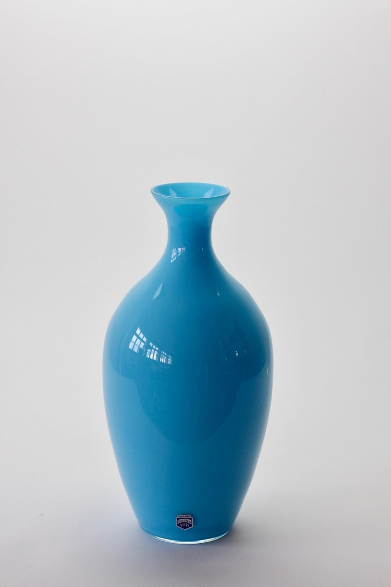 Wonderful light blue vase by Cenedese Vetri of Murano, Italy. A fun, funky and bright way to add a touch of bold color / color to your interior - imagine glass like this on open, white shelving in a kitchen, bathroom or in a display cabinet.