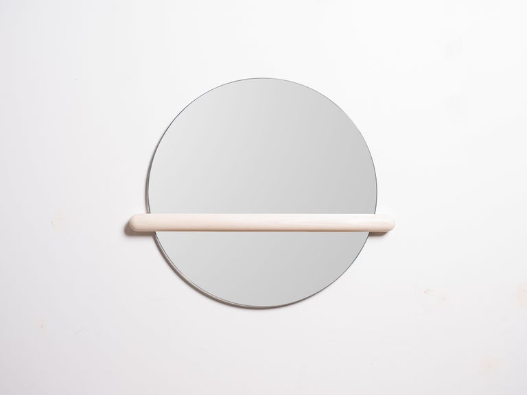 Mirrors are for reflecting but sometimes it's best we don't see the whole picture. Censor mirror intentionally obstructs your reflection to have a new perspective on your image. Easily mounted to the wall with two screws. Mirror slips in and out the