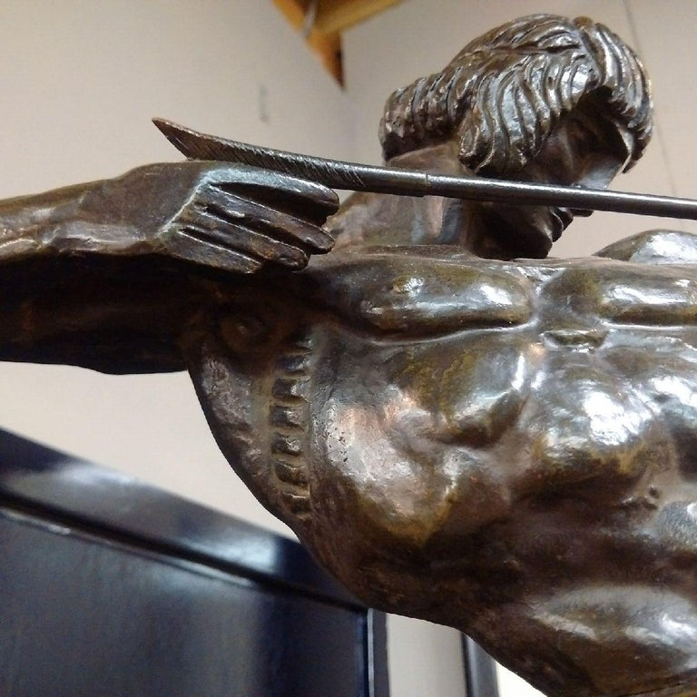 Francois Bazin (French, 1890-1943): a monumental and unique Art Deco bronze sculpture of a Centaur rearing up, drawing back his bow, mounted on green marble plinth, the bronze signed, and marked 'PIÈCE UNIQUE 1924'.  Note: Bazin is regarded as
