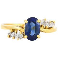 Center Sapphire with Six Diamonds Ring
