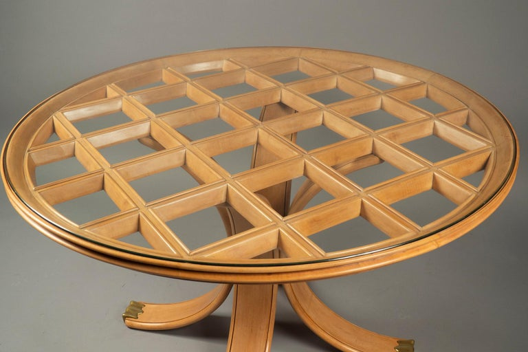 Pearwood table with the top done in lattice work, the four out-splayed legs ending in cast bronze sabots. Original glass top. The piece has been restored to its original condition through us (joints reinforced, wood and bronze cleaned, sealed). This