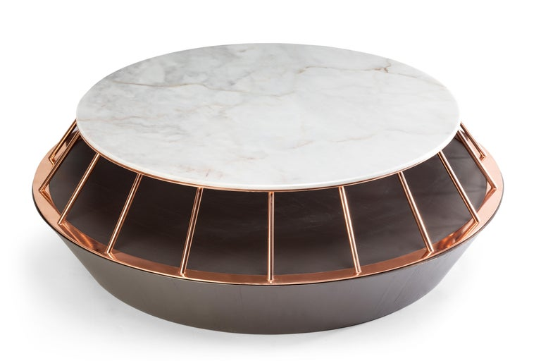 Eileen center table's combination of materials create an original and elegant piece. This center table is made of Estremoz white marble, brass or copper structure and plywood veneer bottom. Made to Order.   For sales with delivery address within