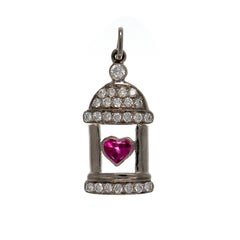18 K White Gold Diamond pavilion with Heart Ruby in center