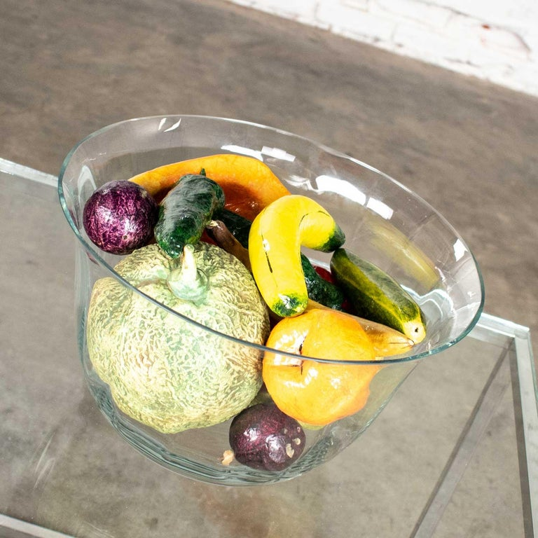 Beautiful centerpiece consisting of large clear glass bowl filled with papier mâché fruit and vegetables plus a ceramic cantaloupe. It is all in wonderful vintage condition with no outstanding flaws we have detected. Please see photos, circa