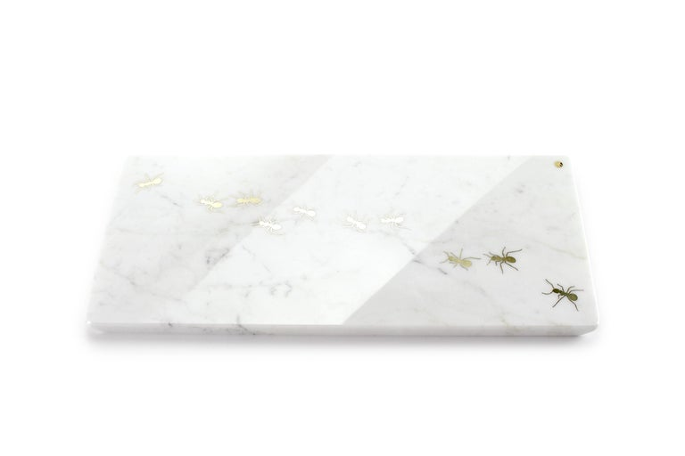 Centerpiece / Serving plate in white Carrara marble with polished brass inlay. Dimensions: Big - L45 W20.5 H1.5 cm Also available: Medium - L45 W12 H1.5 cm or Small - L26 W11 H1.5 cm Material: White Carrara marble, brushed brass.  Pieruga proudly