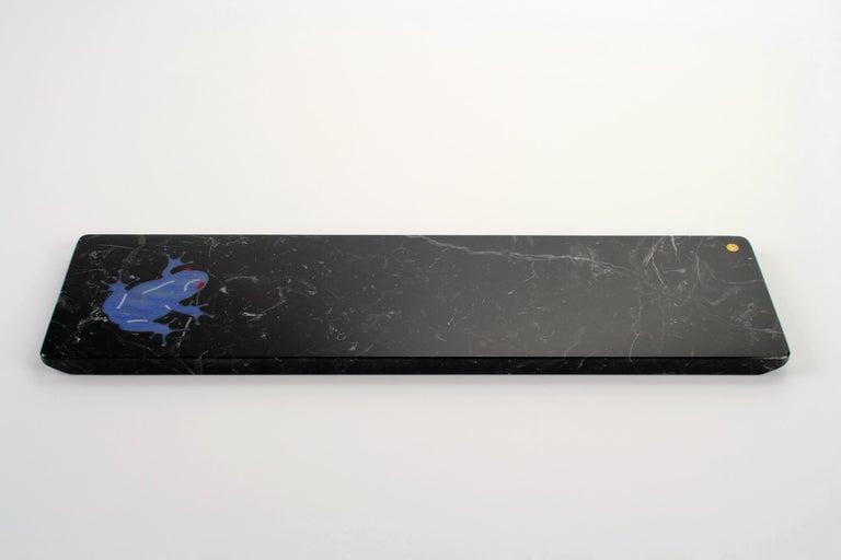 Centerpiece/Serving plate in Marquina marble with semi-precious quartzite Azul Macaubas inlay. Dimensions: Medium L 45, W 12, H 1.5 cm Also available: Big L 45, W 20.5, H 1.5 cm  Material: Marquina marble, semi-precious quartzite Azul
