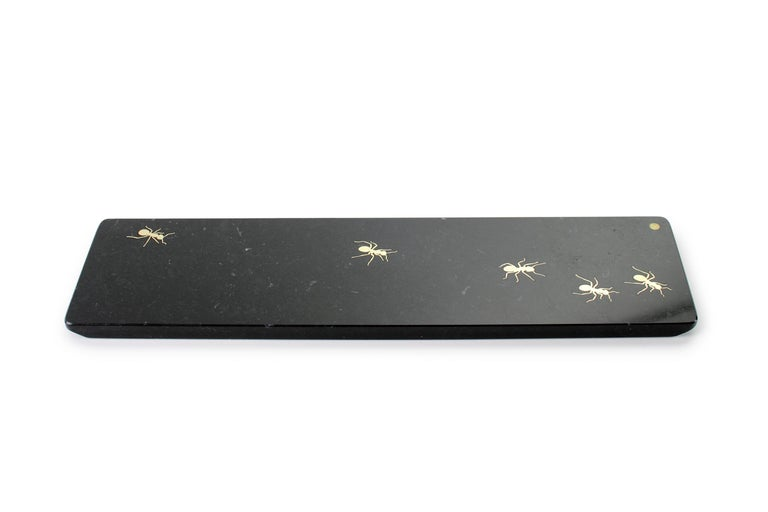 Centerpiece / Serving plate in white Marquina marble with polished brass inlay. Dimensions: Medium L 45, W 12, H 1.5 cm Also available: Big L 45, W 20.5, H 1.5 cm or small L 26, W 11, H 1.5 cm. Material: Marquina marble, brushed brass.  Pieruga