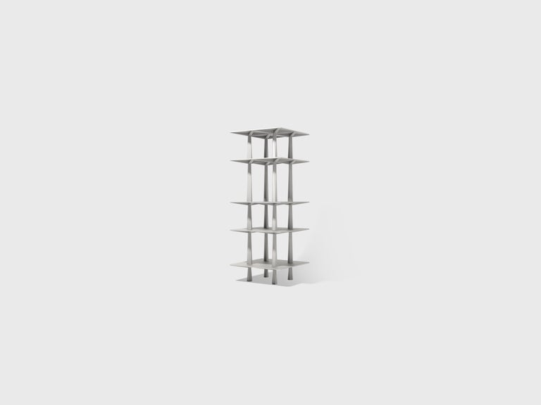 """Centina is an aluminum monolith that domi-nates the habitat; a """"totem for living"""" that remains entirely functional. Its simplicity, elegance and repetition give the object a special character and sense of importance within the domestic landscape."""