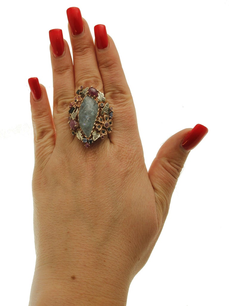 Central Aquamarine Diamonds, Rubies, Blue Sapphires 9 Karat Gold and Silver Ring For Sale 1