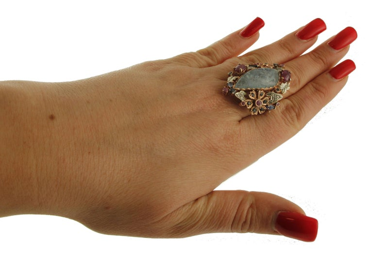 Central Aquamarine Diamonds, Rubies, Blue Sapphires 9 Karat Gold and Silver Ring For Sale 2