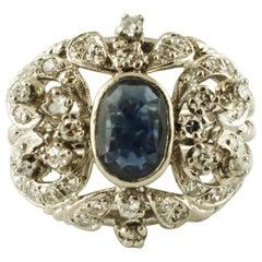 Central Blue Sapphire, Diamonds, 12 Karat White Gold Vintage Ring