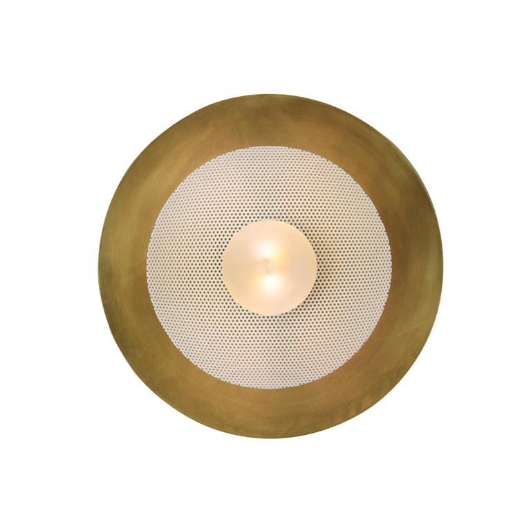 TheCentric wall sconce is a stately take on French modernism, featuring a spun metal mesh shade nestled into a large solid brass bowl. Part of our Axial family of products, theCentric wall sconce is a substantial, handsome piece that works well in