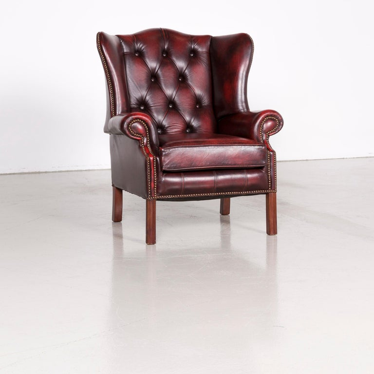 We bring to you a Centurion Chesterfield leather armchair footstool set red vintage.