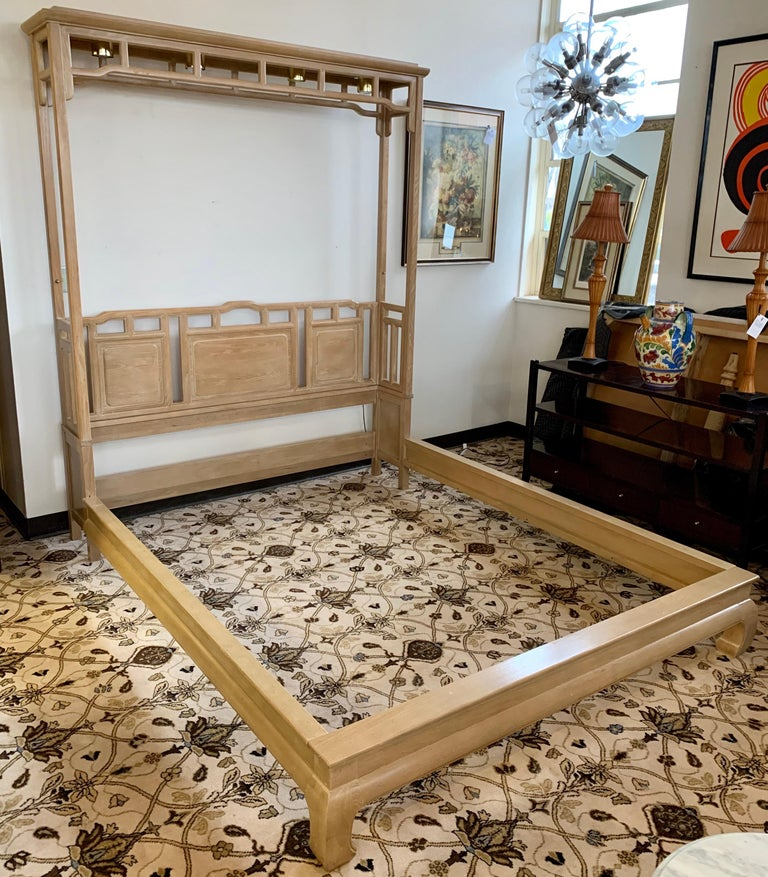Coveted and rare Ray Sabota designed Asian inspired pagoda queen size bed manufactured by Century Furniture, North Carolina, USA in the 1970s. This queen size set features headboard, footboard, rails and attached four light fixtures that are