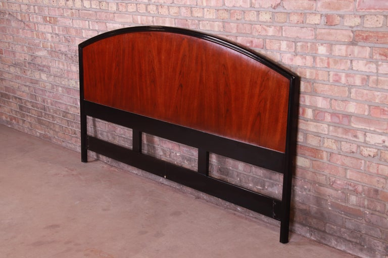 A gorgeous modern king size headboard  By Century Furniture  USA, late 20th century  Bookmatched mahogany, with black ebonized border.  Measures: 81.5