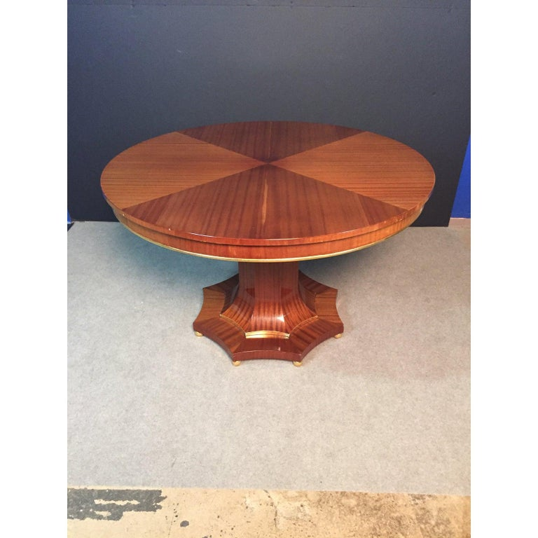 Regency style light golden mahogany center table, with a Biedermeier influence. Gilt accents. Can also be used as a dining table.