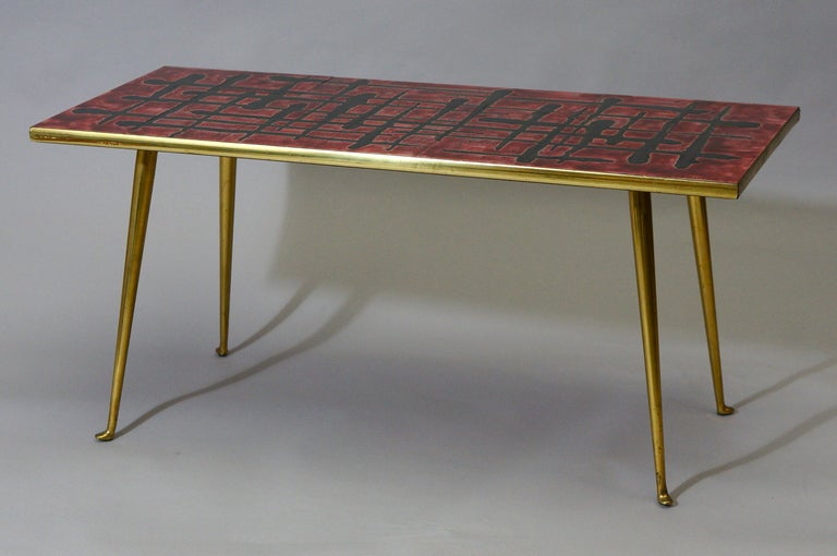 A 1950s French ceramic topped coffee table signed C. De Savigny.