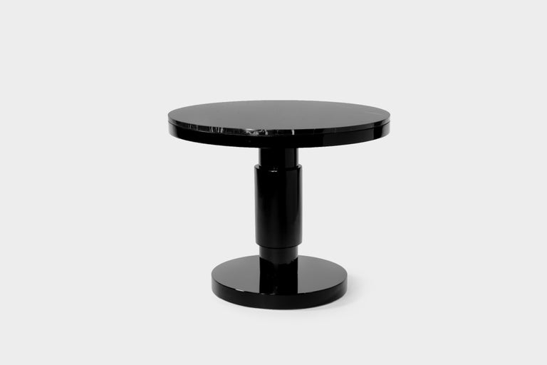 Ceramic and marble large coffee table by Eric Willemart Materials: Top: Polished Nero Marquina marble plate embedded in a black lacquered wooden tray Body: Handcrafted ceramic glazed in black Base: Black lacquered wood on an aluminum