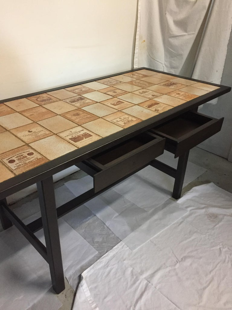 Tiles top Table by Roger Capron French ceramic maker from Vallauris. Representing the Etiquettes of the most prestigious Vineyards Mission Haut Brion .....Beajolais Village.....Clos Vougeot.... The piece is Signed on the Etiquette one :