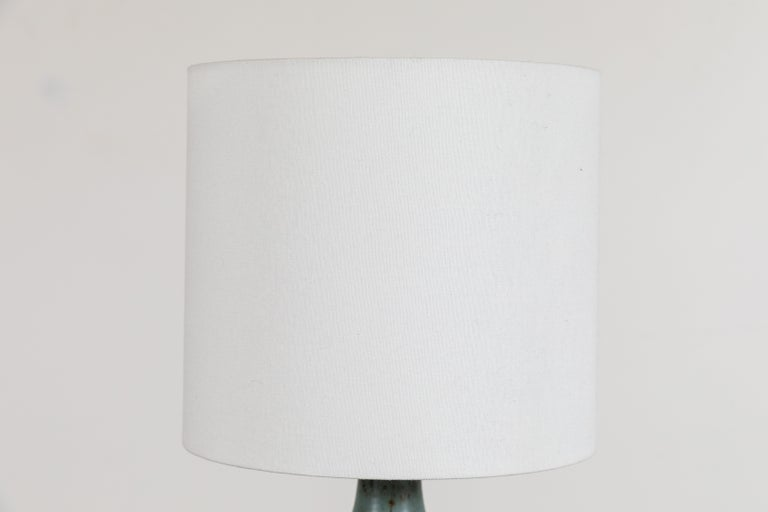 Ceramic bottle lamp by Victoria Morris.