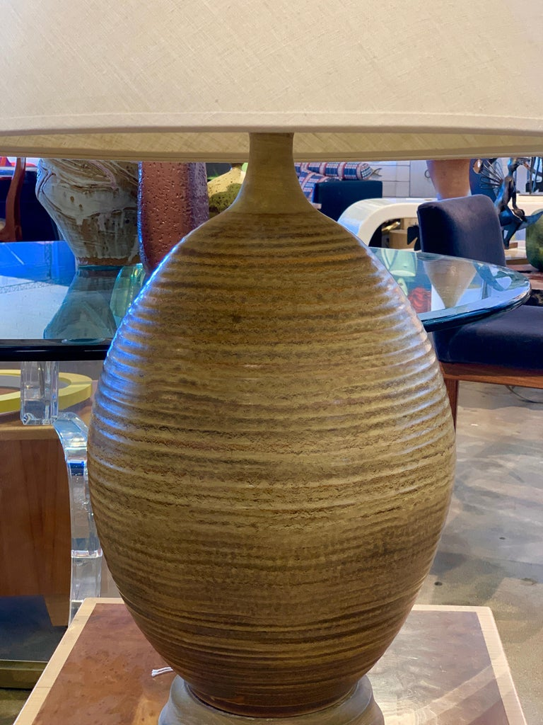 A beautiful large scale ceramic lamp by Bob Kinzie for Affiliated Craftsmen or possible David Cressey. The lamp has been rewired. The shade can be included but is stained. Please let us know if a new one is required. Great scale and presence. The