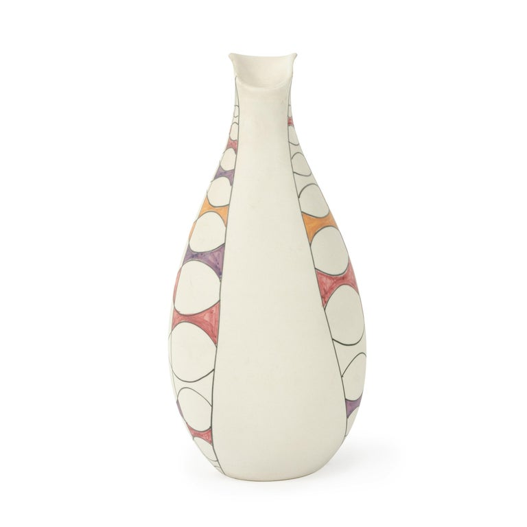 A ceramic vase dipped in white slip and under glazed with curved geometries in pink, yellow and purple. Made in Italy by Raymor, circa 1960s. Marked 'Italy R221 Raymor'.