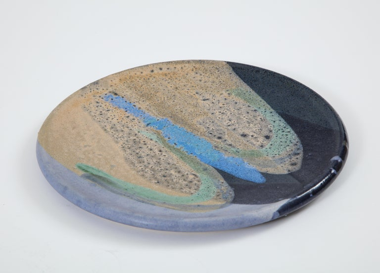 Ceramic plate with abstract enamel glaze, signed 'Helwig'.